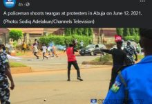 Photo of Outrage As Photo Of Policeman Shooting Teargas At Harmless Protesters Emerges